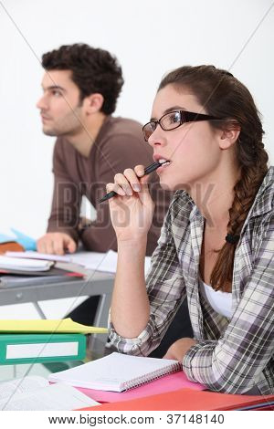 Two students concentrating in class