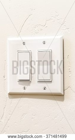 Vertical Crop Indoor Multiple Rocker Light Switch With Broad Flat Levers And Cover Plate