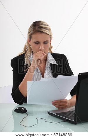 Businesswoman reviewing paperwork