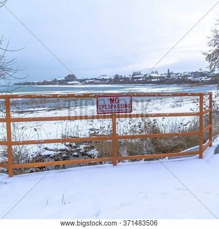 Square Scenic Utah Lake In Winter With No Trespassing Sign A Fence In The Foreground