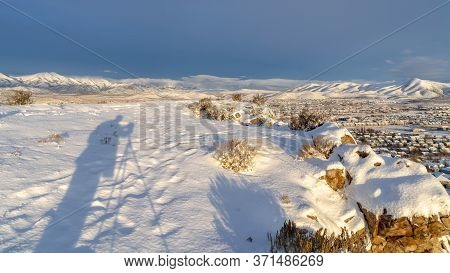 Panorama Frame Snowy Hilltop Over Looking Utah Vally Community And Mountain Against Blue Sky