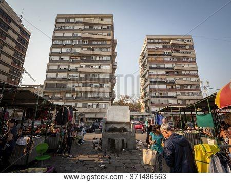 Belgrade, Serbia - October 19, 2019: Panorama Of The Kalenic Pijaca Market With Poor Sellers Passing