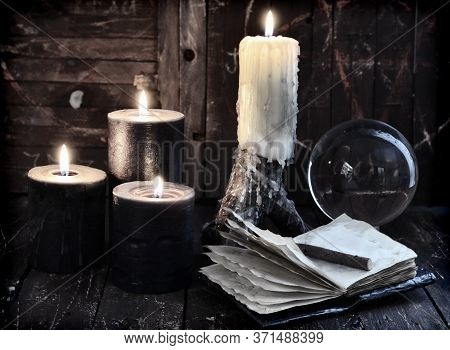 Open Diary, Black Candles And Crystal Ball. Esoteric, Wicca And Occult Background With Magic Objects