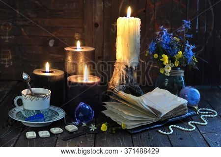 Black Candles, Runes And Open Diary With Empty Pages On Witch Table. Esoteric, Wicca And Occult Back