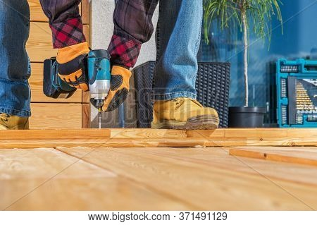 Men Building Wooden Porch Attaching Wood Planks Elements With Large Screws Using Cordless Driver. Sm
