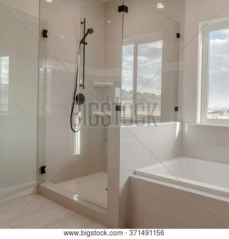 Square Built In Bathtub With Black Faucet And Shower Stall With Half Glass Enclosure