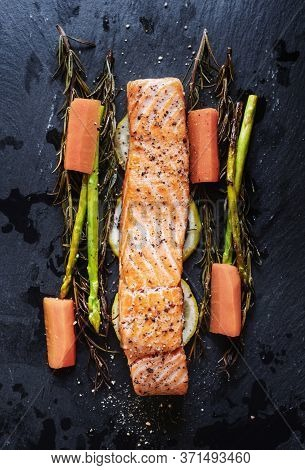 Grilled Salmon Baked Fillet Steak, With Lemon, Asparagus, Rosemary And Carrot