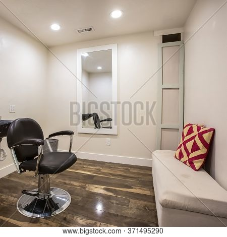 Square Hairdresser Chair And Backwash Shampoo Bowl Inside Salon With Bench And Mirror
