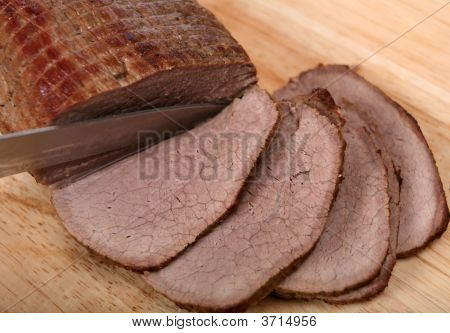 Slicing A Round Beef Joint