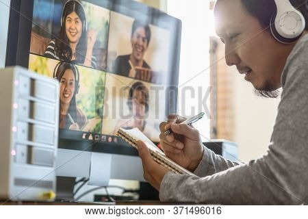 Closeup Asian Man Hand Writing Notebook When Online Learning Via Video Conference With Colleague And