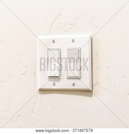 Square Indoor Multiple Rocker Light Switch With Broad Flat Levers And Cover Plate