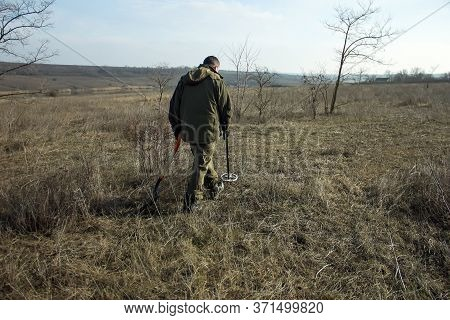 Man With A Metal Detector In Search Of Historical Values.