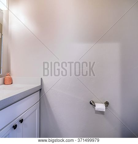 Square Frame Bathroom Interior With View Of Sink Cabinets Wall Mirror Lights And Toilet