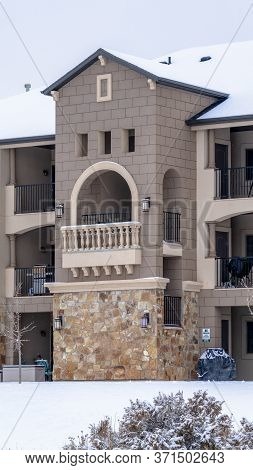 Vertical Beautiful Apartment With Front Gable Roof And Arched Balcony Viewed In Winter