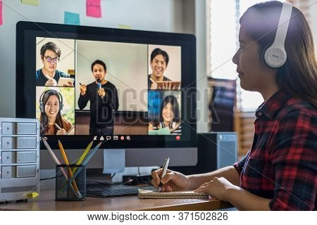 Closeup Asian Woman Hand Writing Lecture When Online Learning Via Video Conference With Teacher Or S