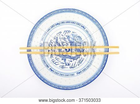 Colorful And Crisp Image Of Asian Dinnerware With Cutlery