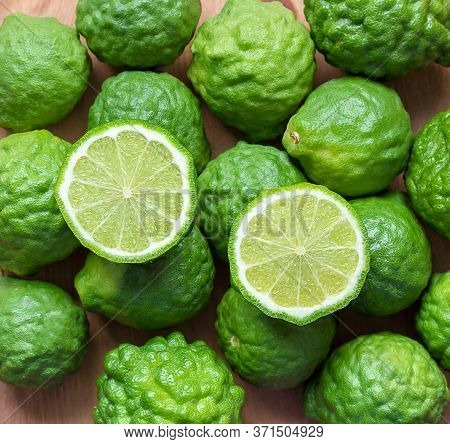 Fresh Bergamot Fruit On Wooden Background,closeup Bergamot Texture Background