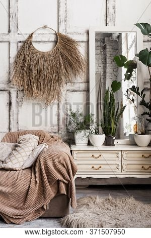 Vertical Photo Of Cozy Living Room Interior In Boho Chic Style With Sofa, Pillows, Textile Plaid, Ho