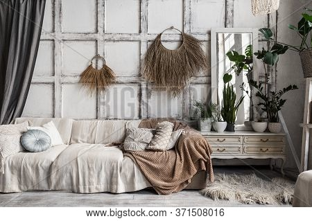 Comfortable Lounge Room Interior In Bohemian Style With Couch, Cushions, Textile Plaid, Decor And Ho