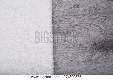 Clear White Towel On The Gray Wooden Table Background. Copy Space, Flat Lay. Teplate For Beauty Shop