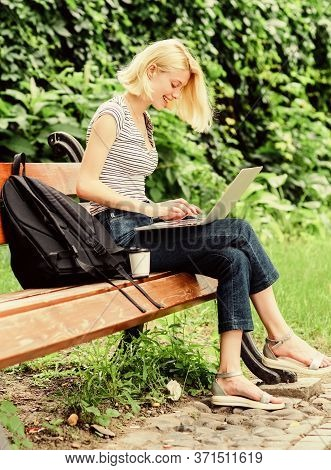 Modern Student Life. Regular Student. Surfing Internet. Girl Adorable Student With Laptop And Coffee