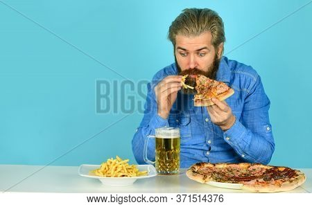Eat And Drink In Bar. American Pub Menu. Man Watching Football While Drinking Beer With Pizza And Fr