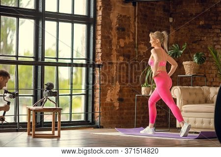 Girl Doing Aerobic On Yoga Mat In Sport Outfit