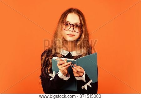 Always Beautiful And Smart Every Moment. Smart Girl Hold Book And Pen Brown Background. Small Child