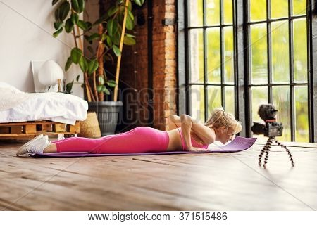 Girl Seating On Yoga Mat In Sport Outfit O Doing Workout At Home On Camera