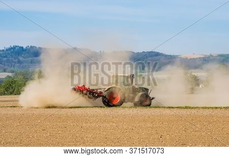 a tractor on dry field