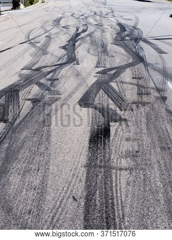 traces of tire wear on a street