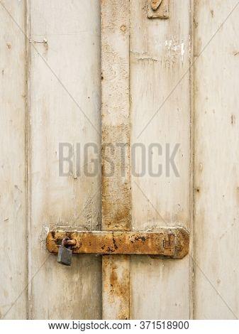 a padlock and a door