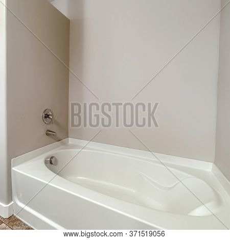 Square Frame Bathtub And Shower Stall With Glass Door Inside Bathroom With Tiles On Floor