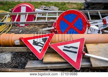 road construction site. construction site signs are lying around
