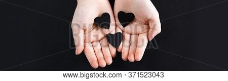 Hands Holding Black Paper Hearts On Dark Background. Support Of Usa Movement Black Lives Matter. Peo