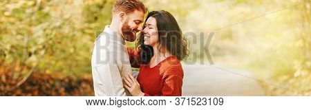 Couple Man Woman In Love. Boyfriend And Girlfriend Hugging Outdoor In Park On Autumn Fall Day. Toget