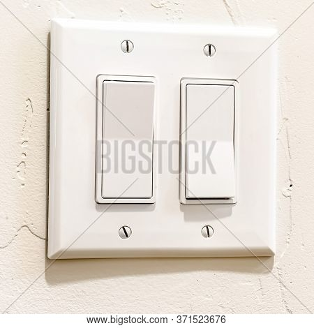 Square Crop Indoor Multiple Rocker Light Switch With Broad Flat Levers And Cover Plate