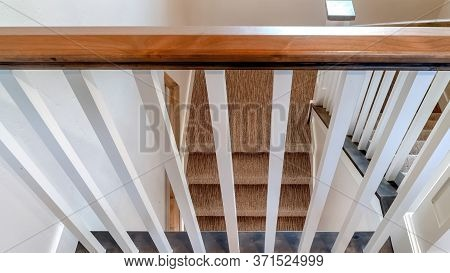 Panorama U Shaped Staircase With White Baluster Brown Handrail And Carpet On Treads