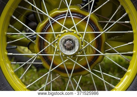 Part Of A Motorcycle Wheel With Spokes.