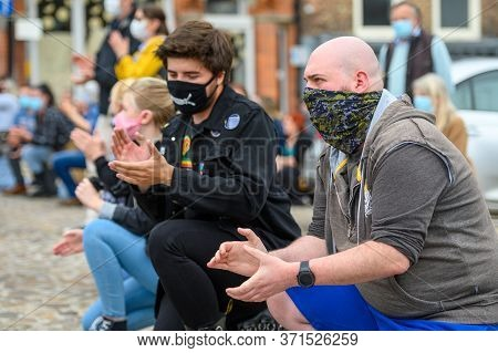 Richmond, North Yorkshire, Uk - June 14, 2020: Protesters Wear Face Coverings While Kneeling At A Bl