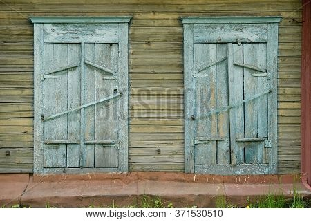 Background Two Old Wooden Painted Windows Closed By Shutters. Village Slums