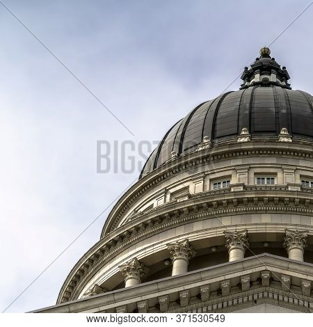 Square Dome And Pediment Of Utah State Capital Building In Salt Lake City Against Sky