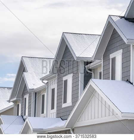 Square Facade Of Snowy Townhouses In South Jordan Utah Against Cloudy Sky In Winter