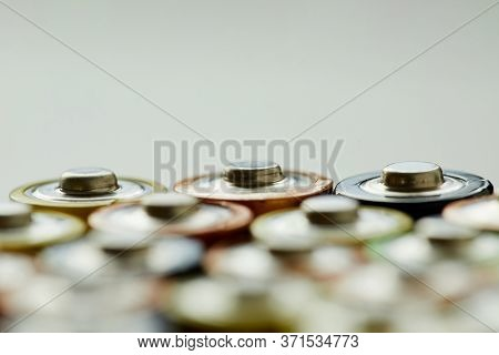 Close-up Of Alkaline Battery Against The Grey Background