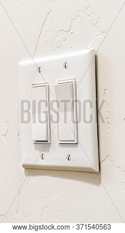 Vertical Wall Mounted Electrical Rocker Light Switch With Multiple Flat Broad Levers