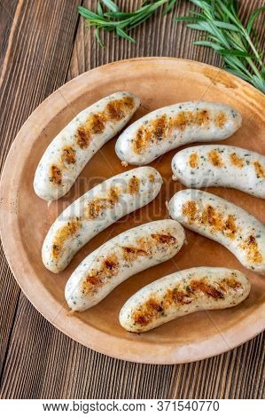 Grilled Bratwurst Sausages On Rustic Plate Flat Lay