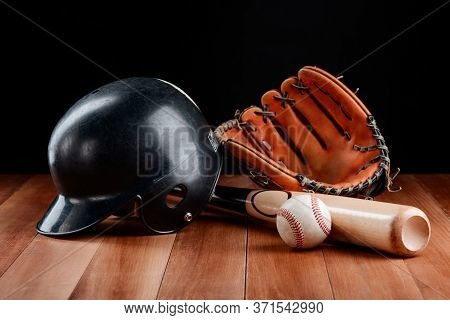 Set Of Baseball Equipment On A Wooden Table
