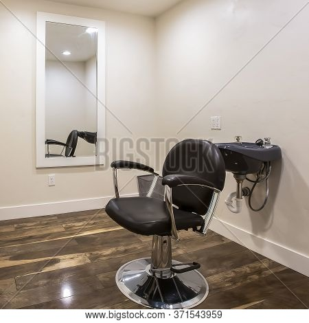 Square Frame Hairdresser Chair And Backwash Shampoo Bowl Inside Salon With Bench And Mirror