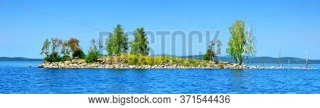 Summer water landscape, the Gull Island on Turgoyak Lake, Southern Urals, Russia. Panoramic summer view, colorful summer landscape scene