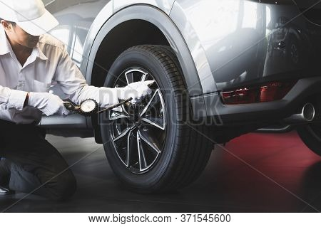 Man Inspection Measure Quantity Inflated Rubber Tires Car Close Up Hand Holding Machine Inflated Pre